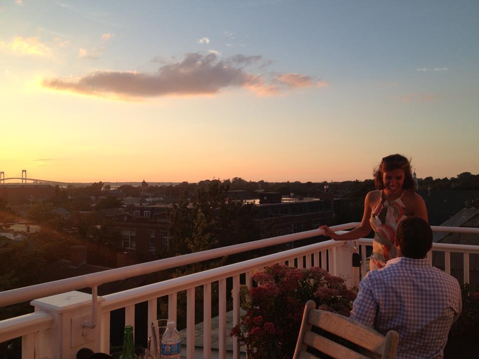 Adam proposes to Amanda on the rooftop deck of the Vanderbilt Grace Hotel in Newport.