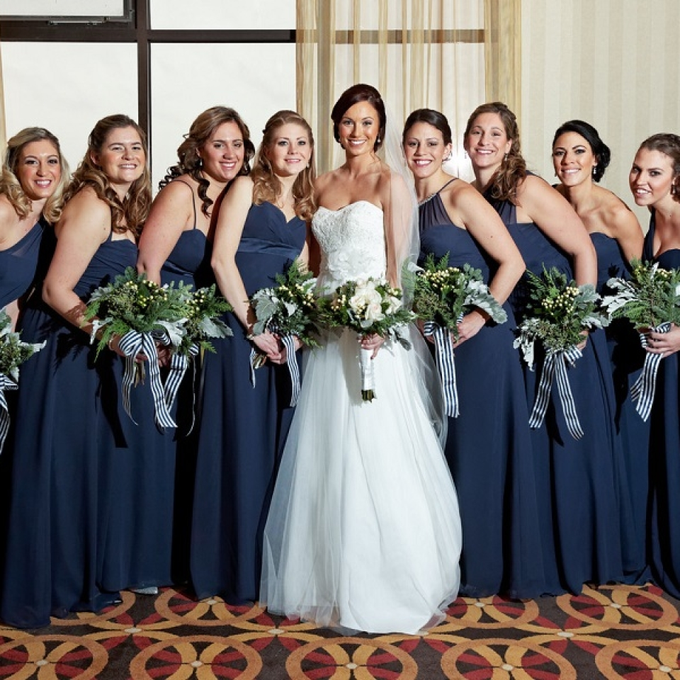 The bridesmaids word navy blue dresses by Alfred Angelo.