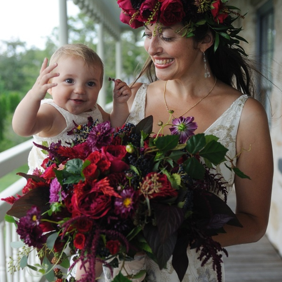 Flowers by Semia created a curated wild look for Gillian's bouquet and floral crown, which featured late summer blooms along with blackberries and blackberry vine.